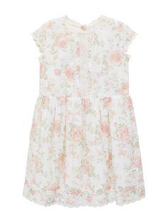 1d25ba1e79ec Blommig klänning med spetsdetaljer och knappar i träimitation bak i ryggen  från Newbie Limited Edition.