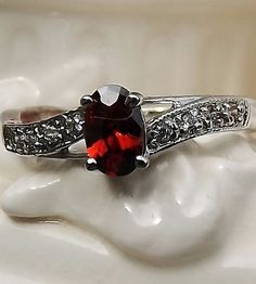 'Genuine Garnet Ring 7' is going up for auction at 11am Sun, Apr 14 with a starting bid of $10.
