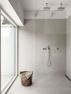 minimalist shower in neutral colour scheme with a large window
