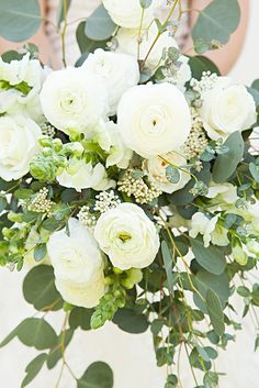 Love the ranunculus & akito roses; snap dragons & stock too -- wedding bouquet