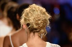 These buns are haute! Pretty twists spotted on this years runway put a couture spin on the go-to bun.