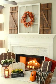 Barn Wood Shutters: From rustic pumpkins to shutters made from barn wood, pallets are the star of this fall mantel display.