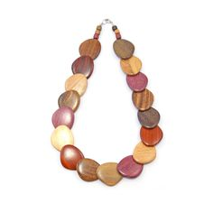 Exotic Wood Necklace - Cala, available at NaturalArtist.com - Treat yourself with this gorgeous boho chic necklace made with high quality natural woods from Costa Rica. It is silky smooth to the touch and oh so pretty with its deep, rich colors. Part of our handmade, fair trade, eco friendly jewelry line.(http://naturalartist.com/products/exotic-wood-necklace-cala.html/)