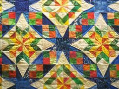 Get out your sunglasses for this quilt – plenty of bright, beautiful colors! It's a Bonnie Hunter Celtic Solstice quilt that incorporates plenty of smart quilting choices by Linda.