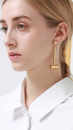 Vertical drop barbells earring. We love the simplicity of this door knocker. Lightweight enough for all day wear yet statement. Earring drop measures 2.5 inches. Hook fastening for pierced ears. care