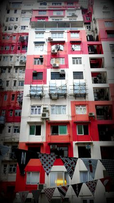 Red and white decorated building in Causeway Bay, Hong Kong, 2012, photograph by Brad Jill.