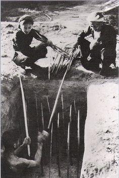 Viet Cong guerrillas laying punji trap near Cu Chi. http://www.winfieldrealestatearizona.com/