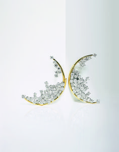 Dancing Jewels | Vogue. Blue Moon earrings in diamond and yellow and white gold DAMIANI