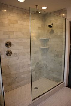 Marble Subway Tile, Doorless walk-in, double shower heads, hexagon floor tile. We should change our shower!
