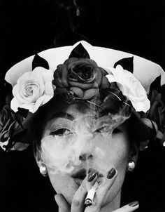 Evelyn Tripp wearing a hat with roses, 1956. Photo by William Klein.