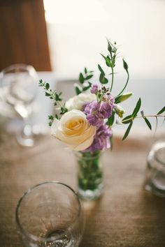 Who says huge floral arrangements have to be the centerpiece?  Delicate blooms in small vases give your tables a sophisticated and intimate feel.