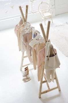 Make a clothing rack for a kids room. This would be great for playing dress up too.