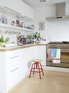 Colourful accessories in textile designer Jane Foster's home in Totnes. | FAKTUM/ABSTRAKT wall cabinets in high-gloss white. | live at IKEA FAMILY LIVE