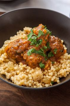 Tunisian Lamb Meatballs are filled with fragrant spices and served with a cinnamon and saffron infused tomato sauce! | TheCornerKitchenBlog.com #meatballs
