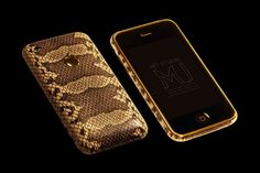Apple IPhone 3G Gold Leather Python MJ Edition. Popular model in a skin of a python. Gilded model – 24 carats, in a skin of a python. The same model from cast gold of 585th alloy. Manufacturing under the order of models of this design with various technical options is possible.   http://exclusive-mj.com/en/