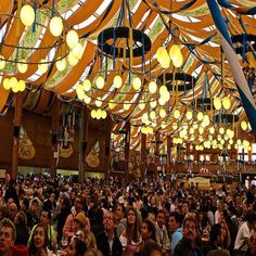 Oktoberfest: Munich Germany -------------------------------------------- This beer hall had trumpeters that played from the balconies. Everyone is looking up at them in this pic.  After the trumpeters is of course the toast to drink. #Munich #Germany #Oktoberfest  All beer served at t