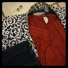 Red Knit Top Elastic around neck and puff sleeves.  Vneck detail.  Banded waistband.  I'm happy to discount on bundles so check out my other listings and make me an offer. Tops Tees - Short Sleeve