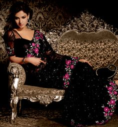 Ultimate collection of embroidered sarees with fabulous style. This black net saree is nicely designed with embroidered patch work is done with resham, sequins, stone and lace work. Beautiful embroidery work on saree make attractive to impress all. This saree gives you a modern and different look in fabulous style. Matching blouse is available. Slight color variations are possible due to differing screen and photograph resolution.