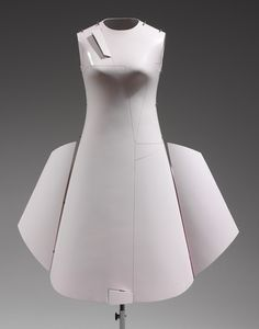 """Airplane"" Dress, spring/summer 2000 (remade 2006) // Hussein Chalayan (British, born Cyprus, 1970) // Fiberglass, metal, cotton, synthetic; L. at center back 37 in. (94 cm) // Purchase, Friends of The Costume Institute Gifts, 2006 (2006.251a–c)"