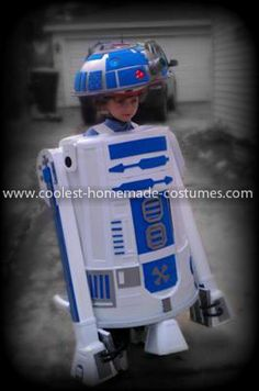Homemade R2D2 Halloween Costume: This R2D2 Halloween Costume is 100% Homemade!  It has lights and sounds too! The costume is made out of a garbage can, bowl mounted to a bike helmet and