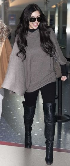 Who made  Kim Kardashian's gray tote, black jeans, aviators, black sweater and thigh high boots tht she wore at LAX airport on January 24, 2011?