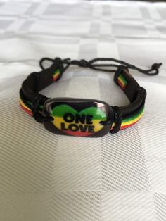 One love unisex bracelet with leather band $9.00