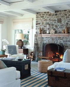 A dash of surfing lifestyle, a hint of seaside boho, add driftwood, indigo blue, sea grass and soft neutral shades found in gathered sea ~ Santa Barbara California Coastal Style Style At Home, Interior Exterior, Interior Design, Living Room Decor, Living Spaces, Santa Barbara Ca, Rock Fireplaces, White Couches, White Walls