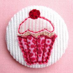 cupcake pin badge by Jenny Arnott