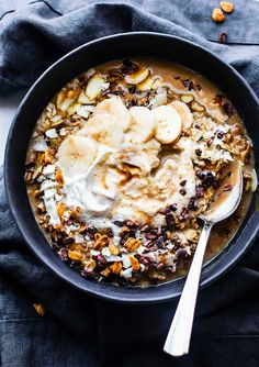 """Vegan Dirty Chai """"Detox"""" Breakfast Bowls that are energy-packed to set your day off right. These detox breakfast bowls are not only healthy and nourishing, but full of anti-oxidants rich spices and immunity boosting nutrients. Gluten free oats, almonds, and quinoa soaked in a coconut milk based dirty chai. Topped with cacao nibs and coconut cream. A breakfast bowl that will perk you up in no time!"""