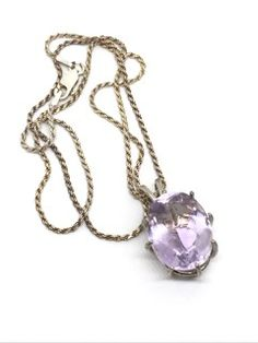 EXQUISITE STERLING SILVER NECKLACE WITH A LARGE GEMSTONE (POSSIBLY AMETHYST) PENDANT. CHAIN MEASURES 18 INCHES IN LENGTH.