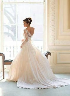 White lace wedding dress with sleeves and open back