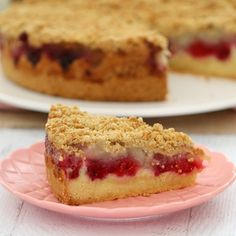 This Raspberry & Apple Crumble Cake has the perfect butter cake base, topped with berries and apple and sprinkled with a crunchy oat crumble.