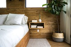 The house boat master bedroom was so small that wide-plank shiplap would've overwhelmed it. This stained skinnylap was perfect and added the modern vibe the owner was hoping for.