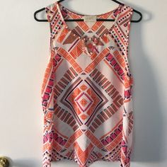 Modcloth Everly Orange Geometrical print tank In like new condition. Sheer tank wears perfect over a nude bra. Purchased from Modcloth. Size L Everly Tops Tank Tops