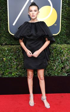 Millie Bobby Brown at the 2018 Golden Globes wearing Calvin Klein.