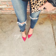 red heels with leopard bag