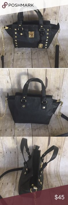 Steve Madden black crossbody bag with gold Steve Madden black crossbody bag with gold hardware.  One zip pocket inside and 2 others.  11.5x8 approx Steve Madden Bags Crossbody Bags