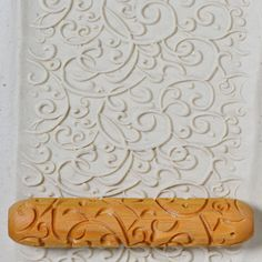 This natural wood hand roller is deeply carved and makes a beautiful imprint on clay, polymer clay and precious metal clay. It is 12cm long (4 inches), and 2.5cm in diameter (1/2 inch plus). It is not laser carved, and all the carving is done with a bevel so that the design releases