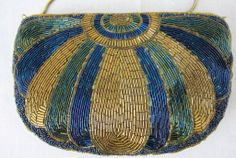 Vintage Art Deco Egyptian Style  Beaded Clutch Hand bag-Gold & Blue | From a collection of rare vintage handbags and purses at http://www.1stdibs.com/fashion/accessories/handbags-purses/
