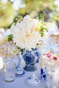 Calling it Home: Blue and White Wedding table settings, inspiration, table centrepieces, ginger jars, white, wedding centerpieces, blues, flower, china