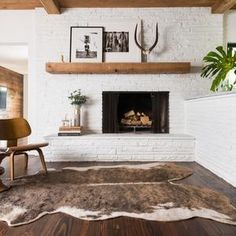 Hold updated with the newest small living room decor ideas (chic & modern). Find great techniques for getting stylish style even though you have a small living room. Brick Fireplace Makeover, White Fireplace, Living Room With Fireplace, Fireplace Design, Rugs In Living Room, Living Room Decor, Scandinavian Fireplace, White Brick Fireplaces, Brick Fireplace Remodel