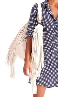 Slouchy shoulder bag with flowing fringe and belted top handle for a luxe, free-spirited feeling.