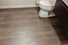 L - A floor option. http://s7d1.scene7.com/is/image/TileShop/Fronda%5FWengue%5FFaux%5FWood%5FBathroom%5FFloor?$Pin%5FGallery%5FLarge$