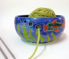 Fish Yarn Bowl  OOOoo I like this idea, or an underwater scene with a diver, and the holes are the diver's bubbles.