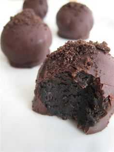 Oreo Truffle Balls:  Ingredients  1 8oz pkg of cream cheese (softened) 1 16.6oz pkg of Oreo Cookies, finely crushed (makes 4 1/2 cups) 2 pkgs (8 squares each) Bakers Semi Sweet Chocolate, melted (you can use mini chocolate chips as well)  Mix cream cheese and 3 cups of crushed Oreo's until well blended ( I crush my Oreo's in my food processor and then blend in the cream cheese)  Shape into 48 1-inch  balls then refrigerate for 30 minutes