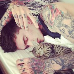 Boy with Tattoos + Kitten snugly time. This could go in various boards: kitties, ink, or this one because it combines kitties and a tattooed boy who snuggles with kitties. This board won.