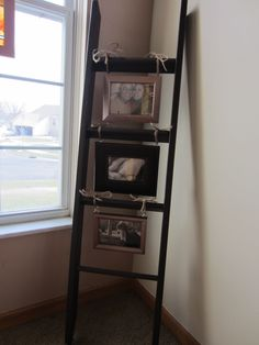 "I had this old bunk bed ladder and finally figured out what to do with it! I used some frames I had, spray painted two of them a metallic light copper. I printed out some pictures in ""sepia"" and then hot glued picture hangers on the frames so I could tie them to the rungs. I tied them with juke twine."