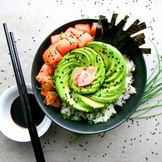 Sushi Bowl with Salmon, Sushi Rice, Nori, Avocado, Pickled Ginger, Soy and Wasabi.