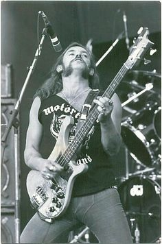 """a black and white photo of LEMMY KILMISTER, the legendary bass player, songwriter and the founder member of the legendary rock and roll band MOTORHEAD  """"The World's No:1 Online Heavy Metal T-Shirt Store"""". Check it out NOW; www.HeavyMetalTshirts.net"""
