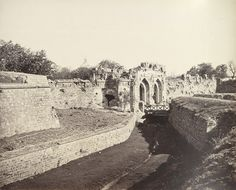 This photo by Samuel Bourne in the 1860s; part of an album titled 'Photographs of India and Overland Route'. The Kashmir Gate, at the northern end of the the Mughal city of Shahjahanabad at Delhi, was the scene of desperate fighting when the British retook the walled city during the Indian Mutiny, 1857. Similar photo also by Felice Beato.